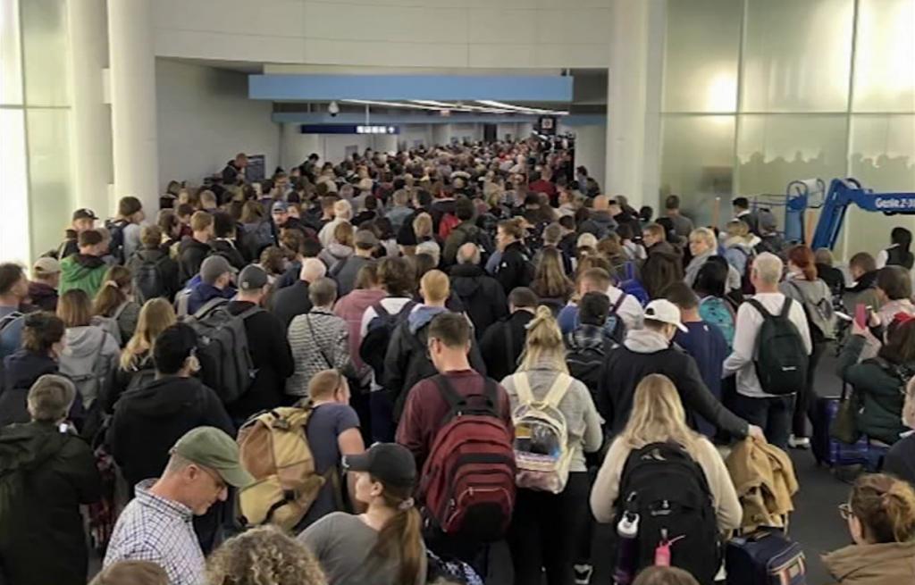 Hundreds of inbound passengers wait in a coronavirus screening line at Chicago's O'Hare International Airport